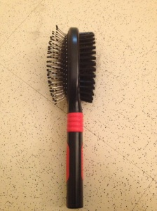 This is a two-sided hairbrush. On one side is a brush that they don't recommend. It has metal bristles with the little rounded dot on the end. The other side is soft and is what I used to groom Makiko after the Zoom Groom.