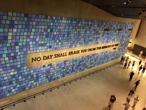 """Quote: """"No day shall erase you from the memory of time."""" Blue tiles surround this quote."""